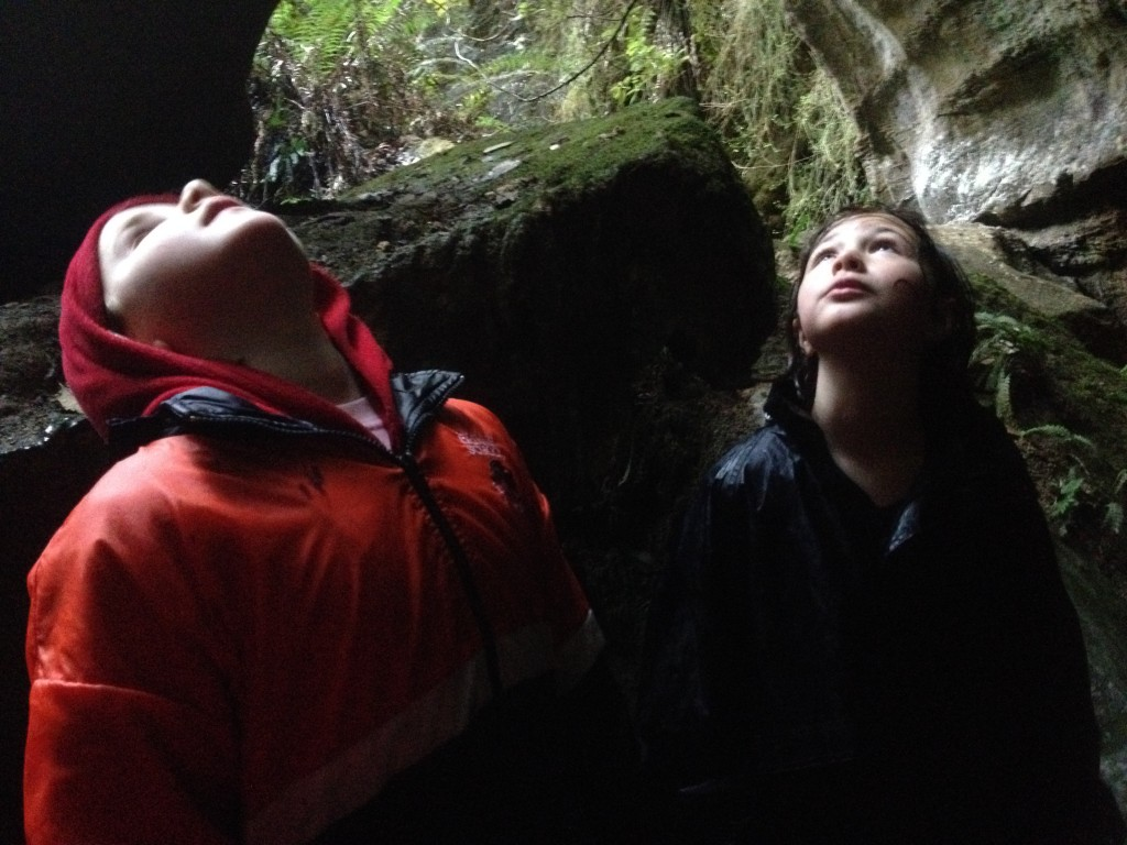 Looking at the cliff face above the cave